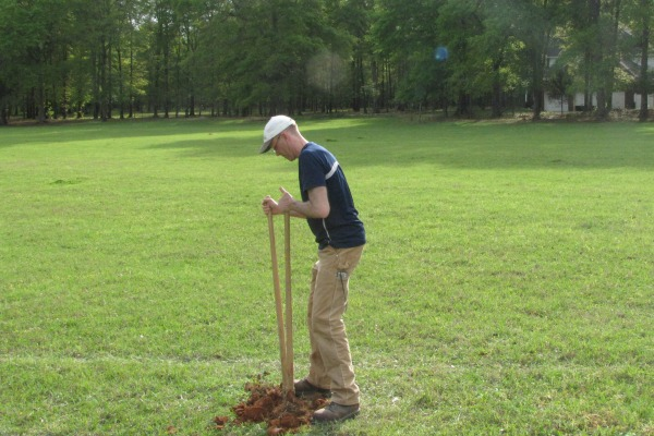 Dr. Stephen Ogle digging for soil samples