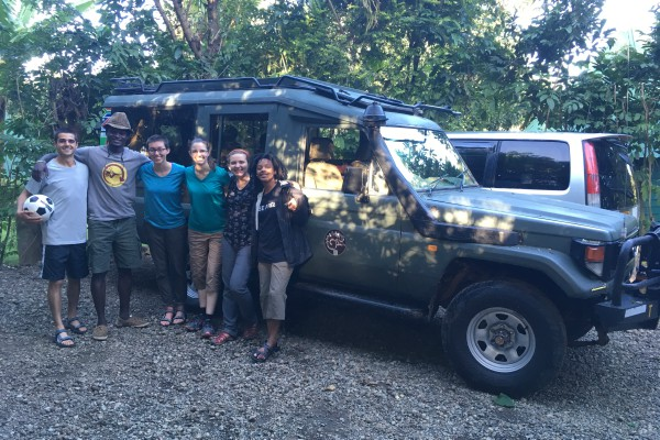 African field crew in front of Land Rover