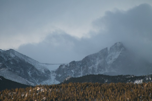 Mountain being enveloved in winter storm clouds