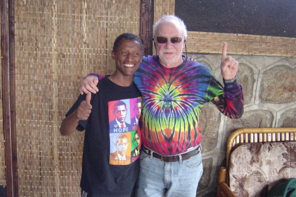 Dave Swift posing with African boy