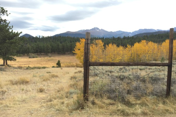 Fence with mountain range in the distance.