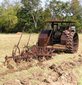 Old tractor and tilling system.
