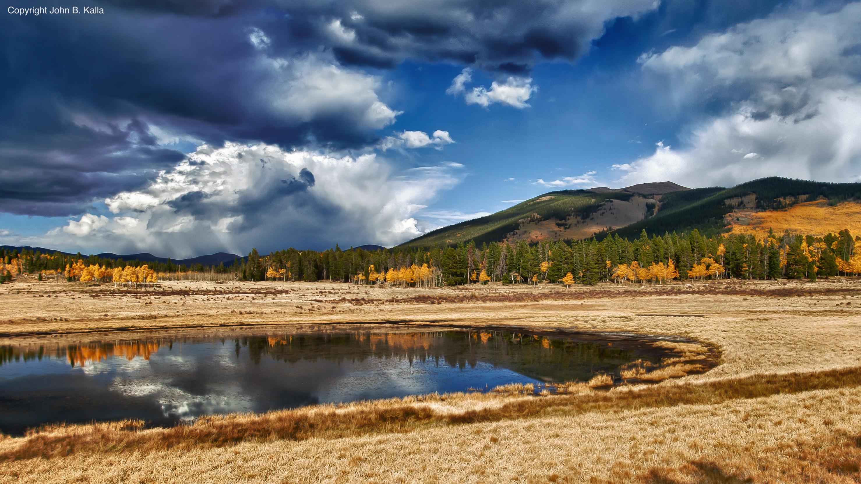Colorado wetland under stormy skies