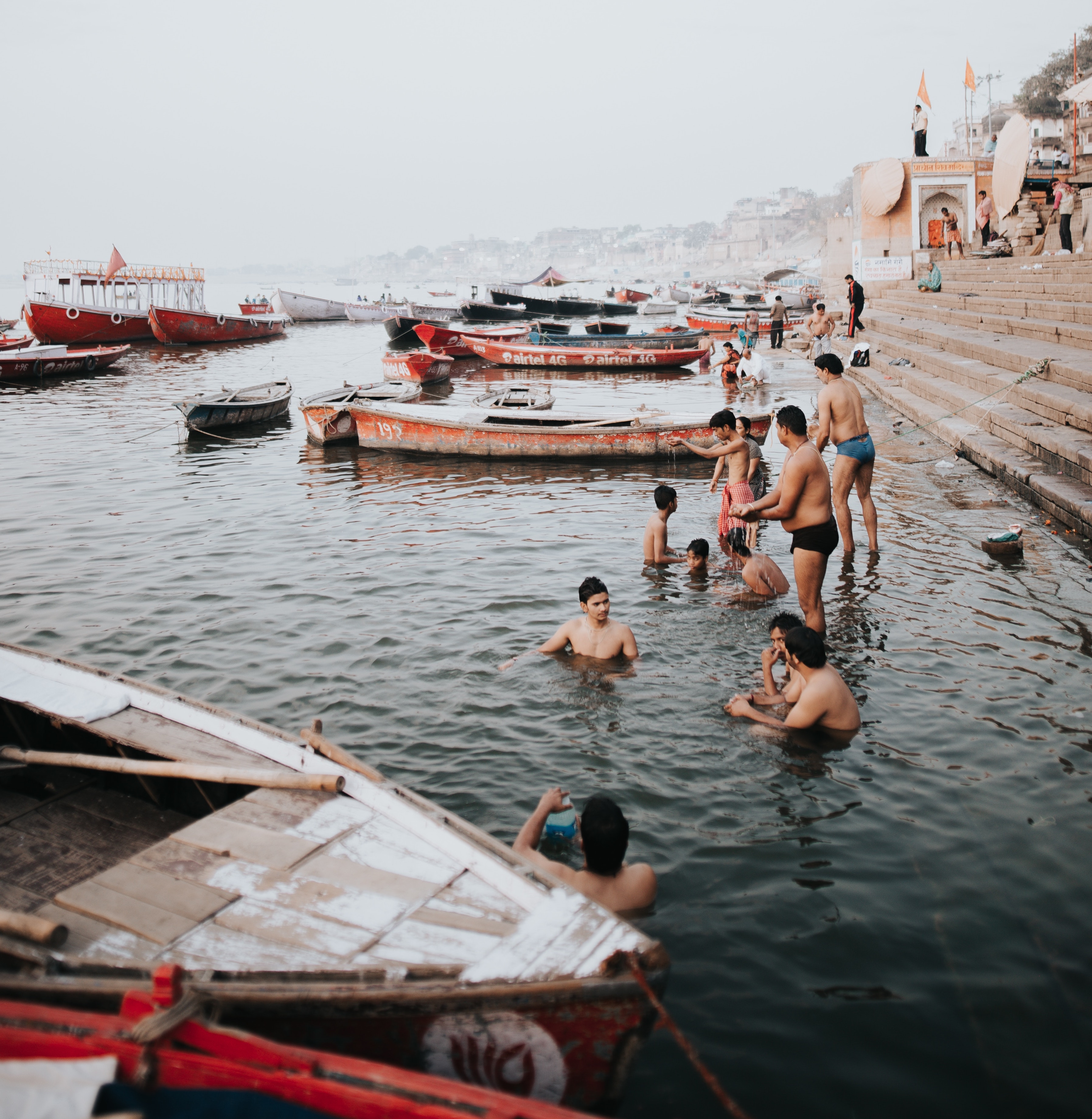 people bathing by river in India