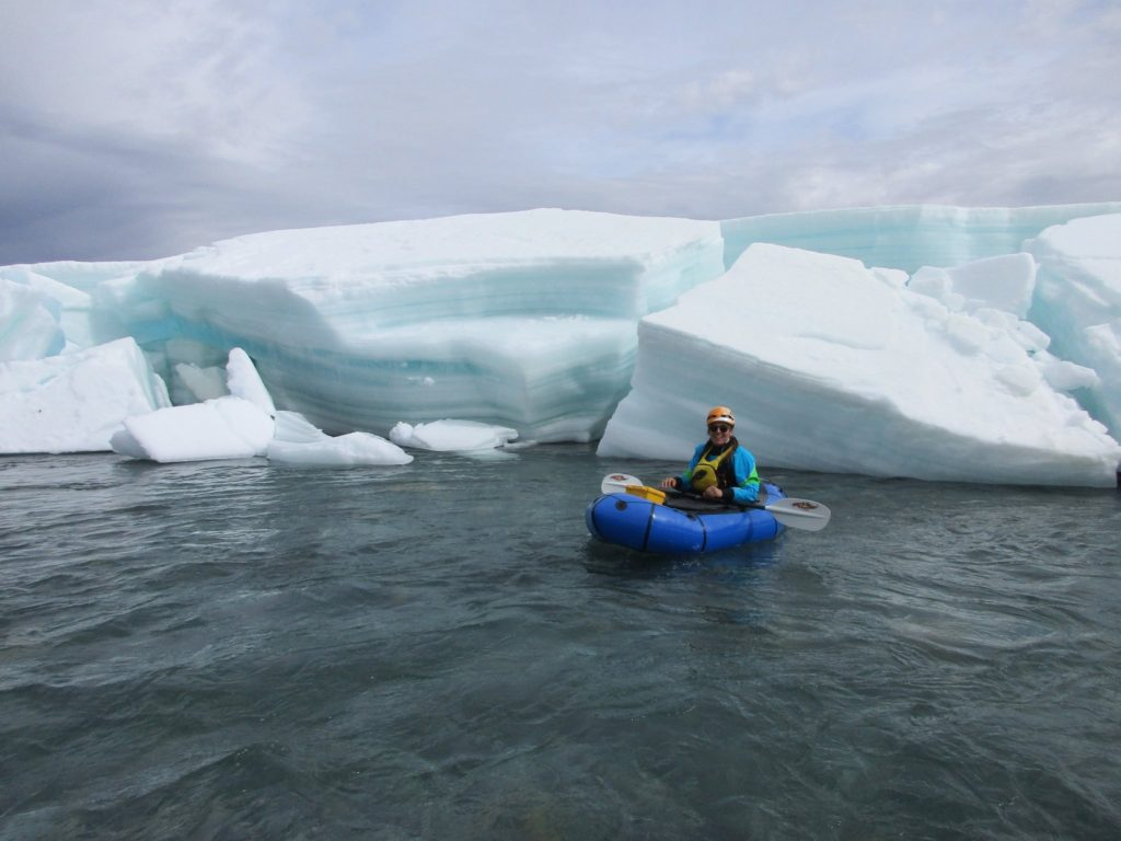 Claire Carver kayaking in a glacier lake