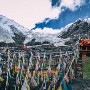 Tibetan landscape with prayer flags in foreground